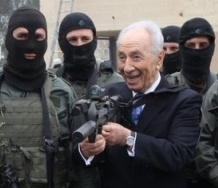 peres with gun-small-cut