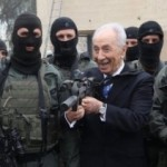 peres-with-gun-small1