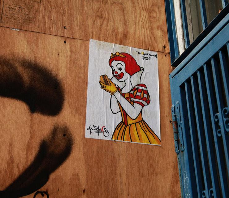 """שלגיה וההמבורגר המורעל / אמן הרחוב Mr. OneTeas, ארה""""ב, 2014."""