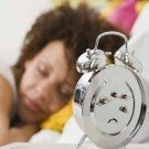 woman-sleeping-alarm-clock-thumb